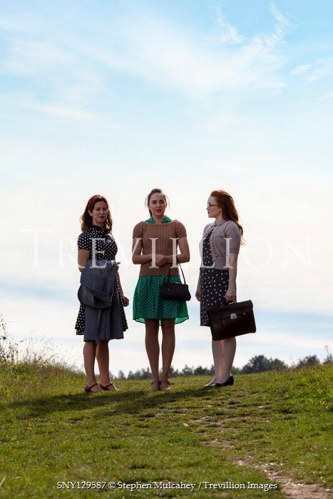 Stephen Mulcahey THREE WOMEN STANDING IN SUMMERY COUNTRYSIDE Groups/Crowds