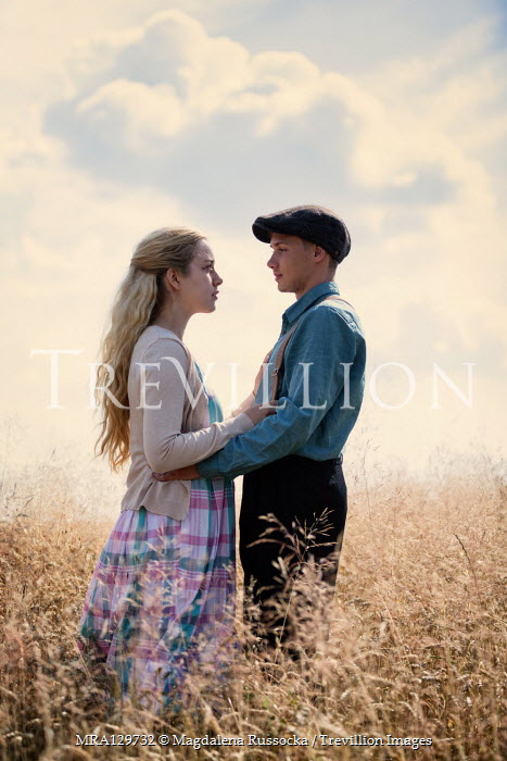 Magdalena Russocka retro couple embracing in field