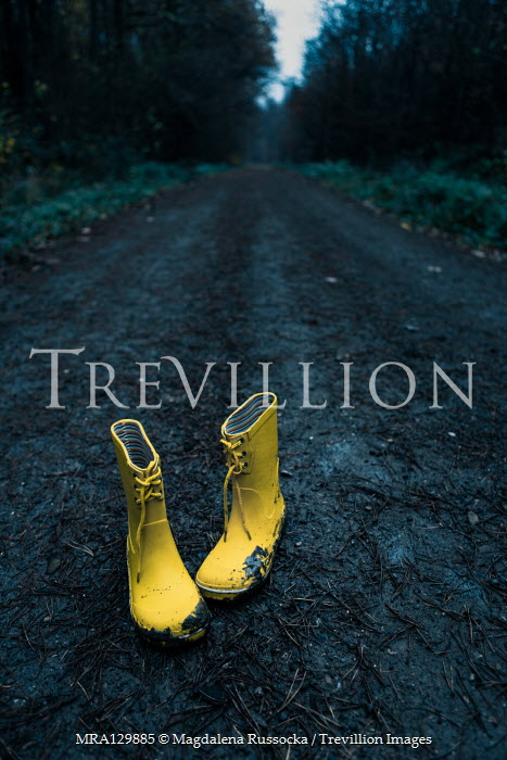 Magdalena Russocka yellow child's wellies abandoned on muddy road in forest