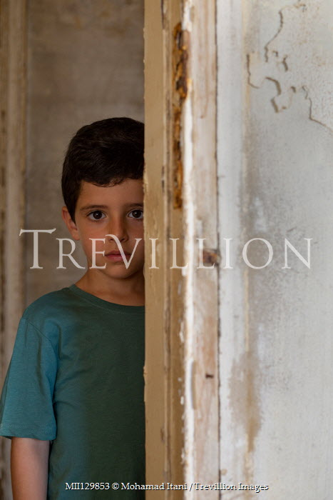 Mohamad Itani LITTLE BOY SITTING BY SHABBY WALL Children