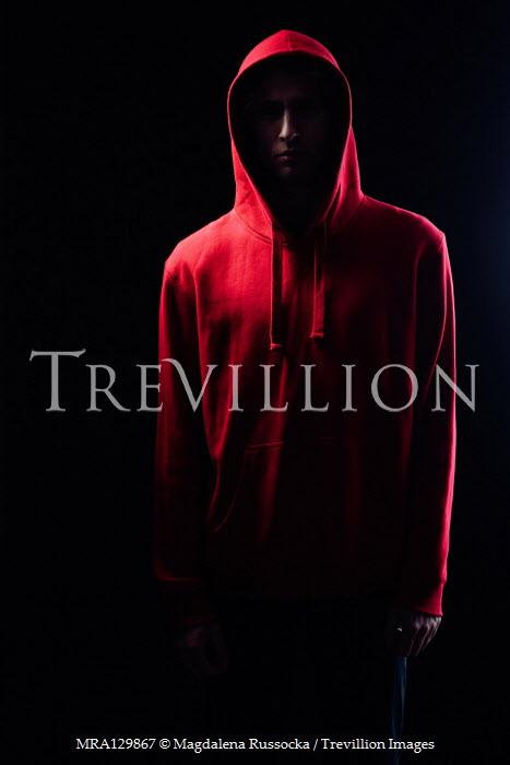 Magdalena Russocka modern man wearing red hoodie in shadow  insiade