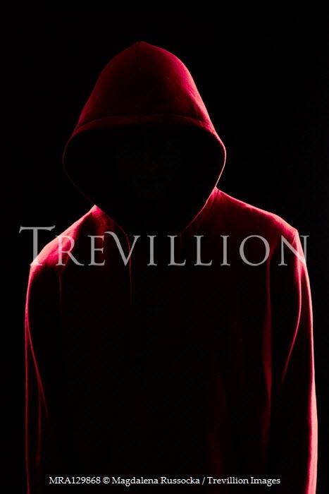 Magdalena Russocka faceless modern man wearing red hoodie in shadow insiade