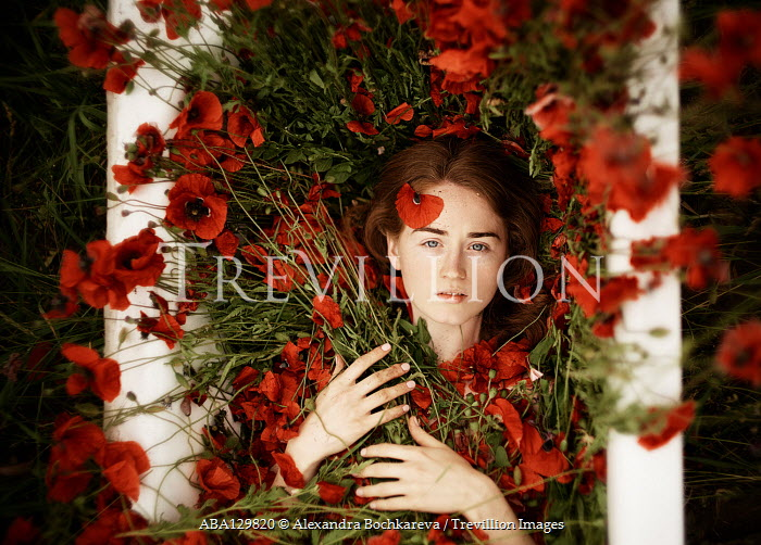 Alexandra Bochkareva WOMAN LYING WITH RED POPPIES Women
