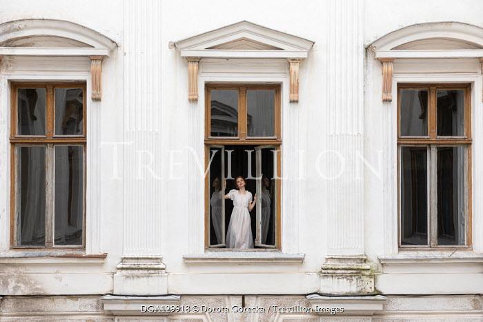 Dorota Gorecka GIRL STANDING AT WINDOW OF GRAND HOUSE Women