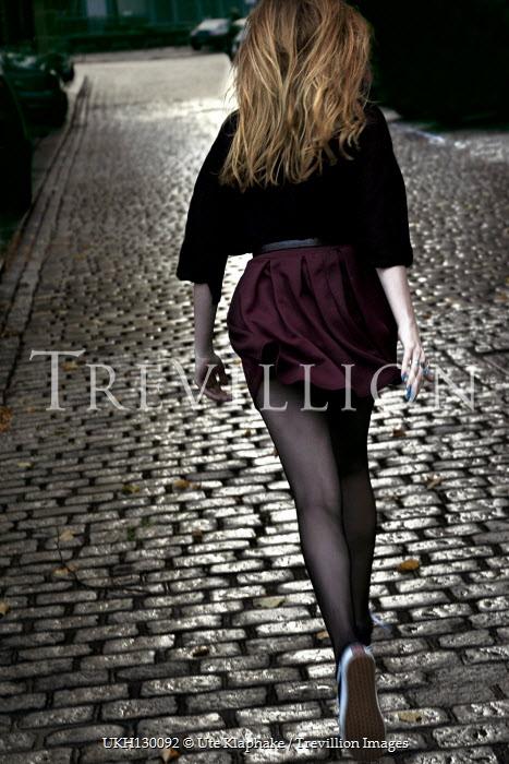 Ute Klaphake WOMAN RUNNING ON COBBLED STREETS Women