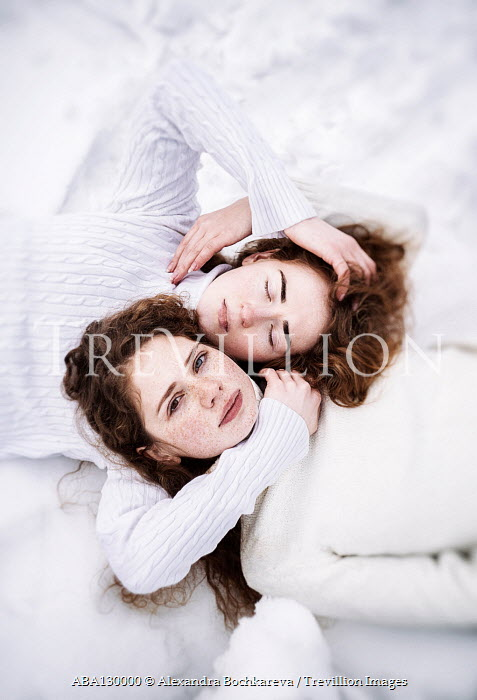 Alexandra Bochkareva TWO GIRLS IN WHITE SWEATER LYING IN SNOW Women