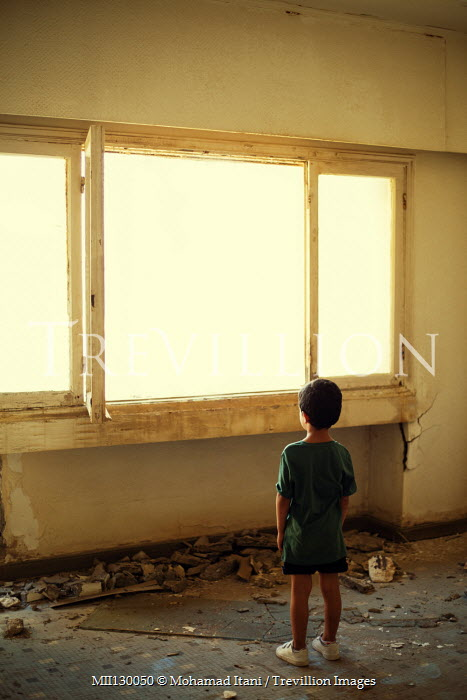 Mohamad Itani LITTLE BOY IN DERELICT BUILDING WATCHING WINDOW Children