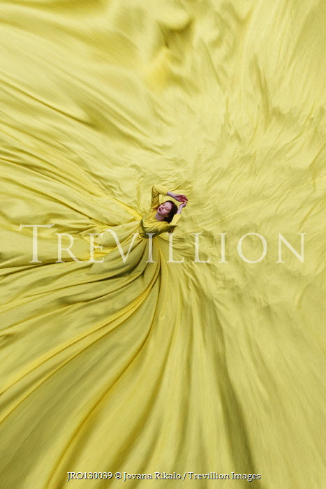 Jovana Rikalo WOMAN WITH FLOWING DRESS AND FABRIC FROM ABOVE Women