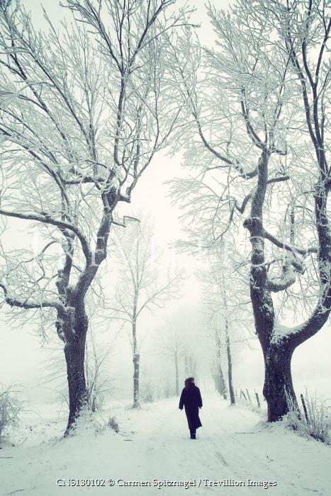 Carmen Spitznagel Woman in black coat walking on road in winter