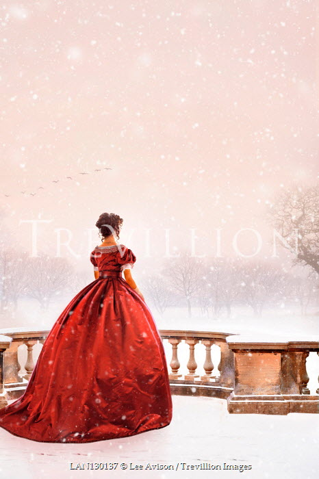 Lee Avison Victorian woman in a red dress watching snow falling