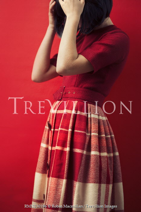 Robin Macmillan Young woman in checked red skirt and blouse