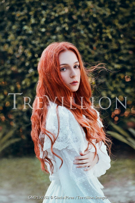 Giada Piras Young woman in white dress in garden