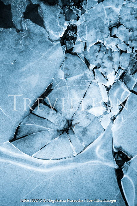 Magdalena Russocka close up of frozen water with cracked ice