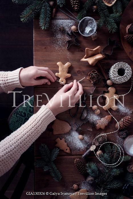 Galya Ivanova WOMAN MAKING BISCUIT DECORATIONS FOR CHRISTMAS TREE Women