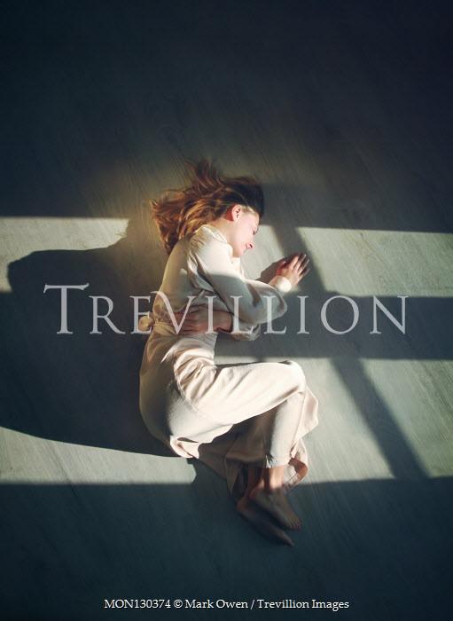 Mark Owen WOMAN IN DRESS LYING ON FLOOR WITH SHADOWS Women