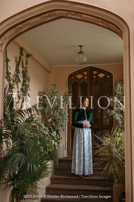 Shelley Richmond REGENCY WOMAN IN HOUSE ON STEPS WITH PLANTS Women