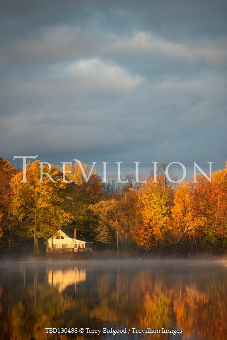 Terry Bidgood House by lake during autumn
