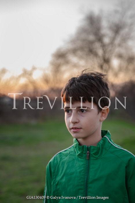 Galya Ivanova Boy in green jacket at sunset