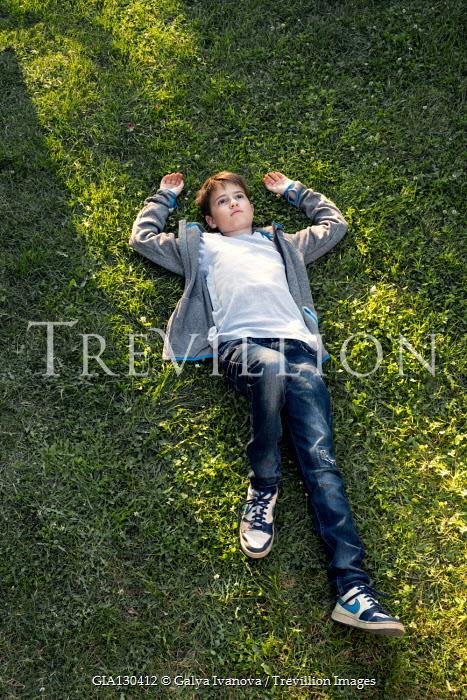 Galya Ivanova Boy lying in grass