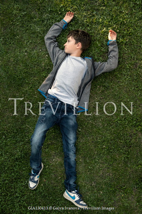 Galya Ivanova Boy lying in grass