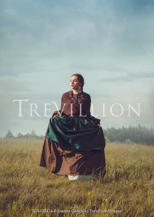Joanna Czogala Young woman in Victorian dress in field