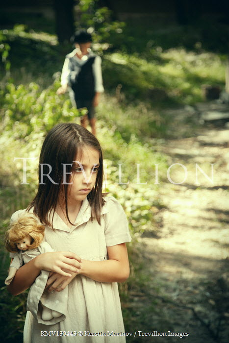 Kerstin Marinov Girl with doll in park with boy
