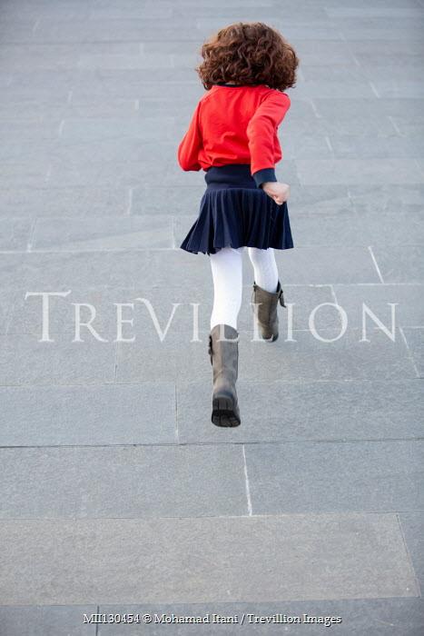 Mohamad Itani Girl running on footpath