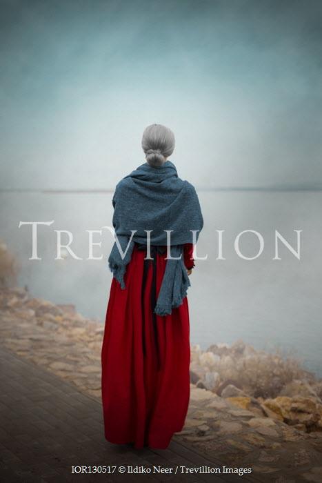 Ildiko Neer Old historical woman standing by lake