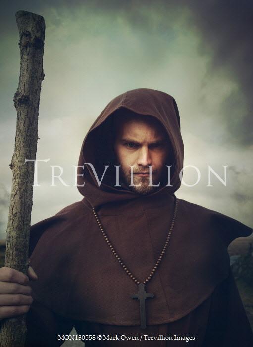 Mark Owen Monk in brown robes holding stick