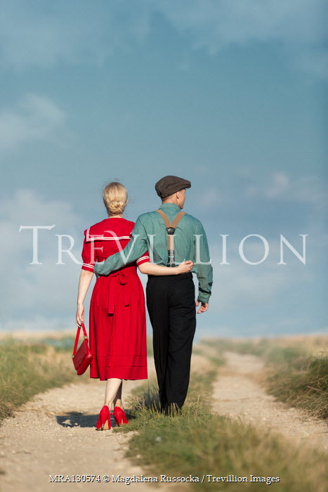Magdalena Russocka Couple walking on country road