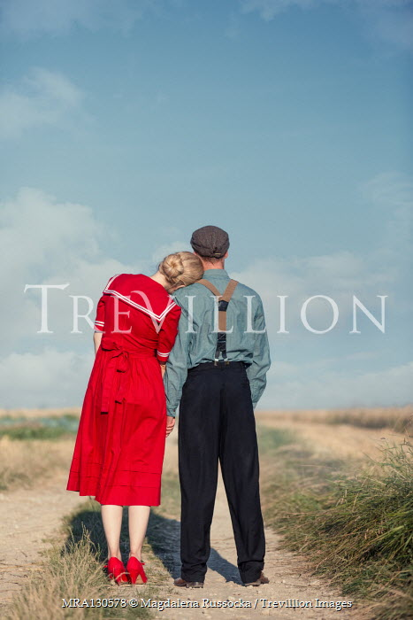 Magdalena Russocka Couple embracing on country road