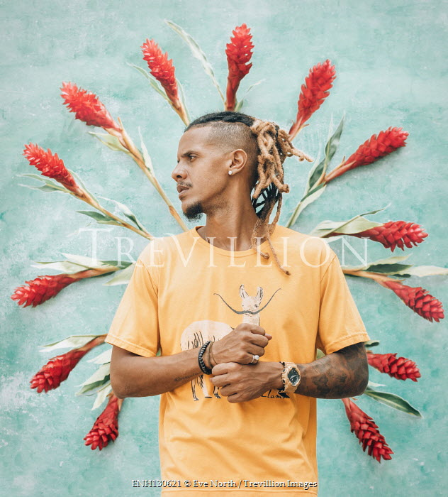 Eve North Young man with dreadlocks and red flowers