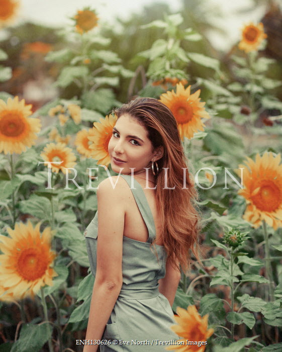 Eve North Young woman in sunflower field