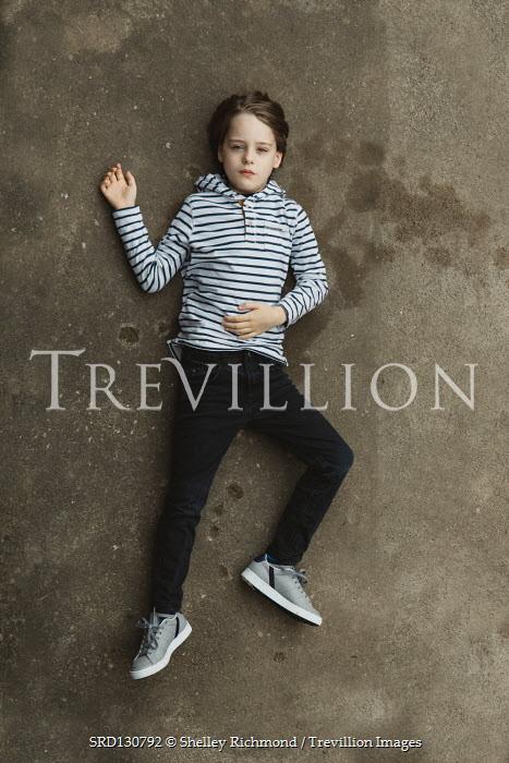 Shelley Richmond LITTLE BOY LYING ON GROUND IN STRIPY TOP Children