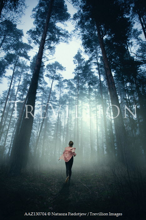 Natasza Fiedotjew Young woman running in woods
