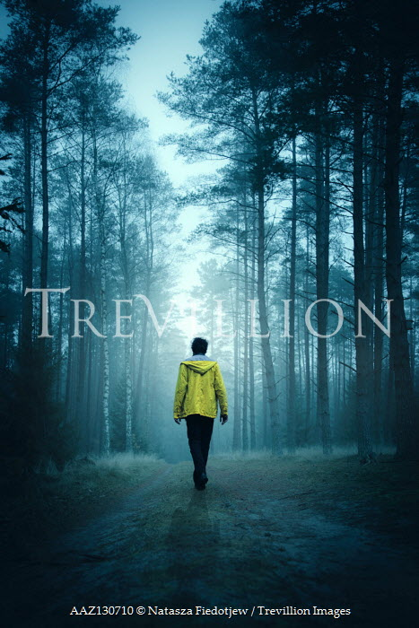 Natasza Fiedotjew Young man in yellow raincoat walking in woods