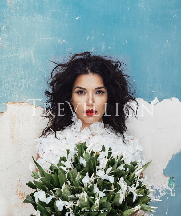 Eve North BRUNETTE WOMAN COVERED IN PETALS HOLDING WHITE FLOWERS Women
