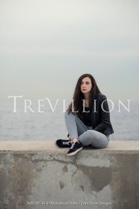 Mohamad Itani GIRL IN LEATHER JACKET SITTING ON SEA WALL Women