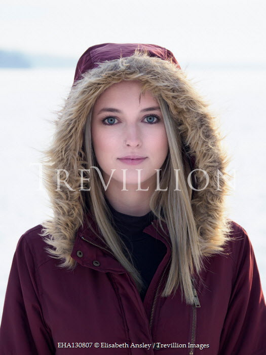 Elisabeth Ansley BLONDE WOMAN WITH FUR HOOD OUTDOORS IN SNOW Women