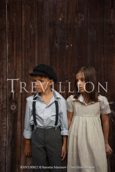 Kerstin Marinov WORRIED LITTLE GIRL AND BOY BY WOODEN DOOR Children