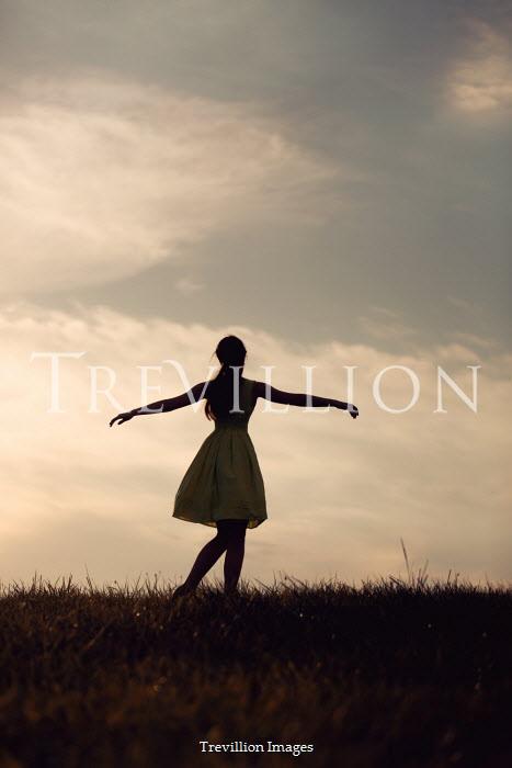 Magdalena Russocka teenage girl in field at sunset