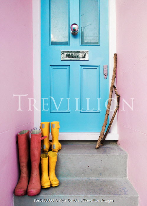 Kyle Stubbs WELLIES AND STICKS ON DOORSTEPS OF HOUSE Miscellaneous Objects