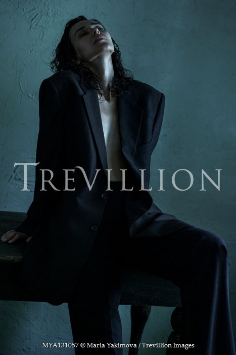 Maria Yakimova Young woman sitting in black coat