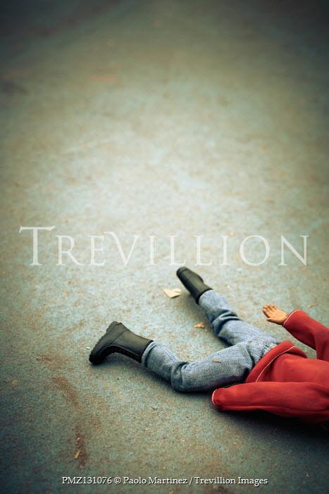 Paolo Martinez Action figure lying on concrete