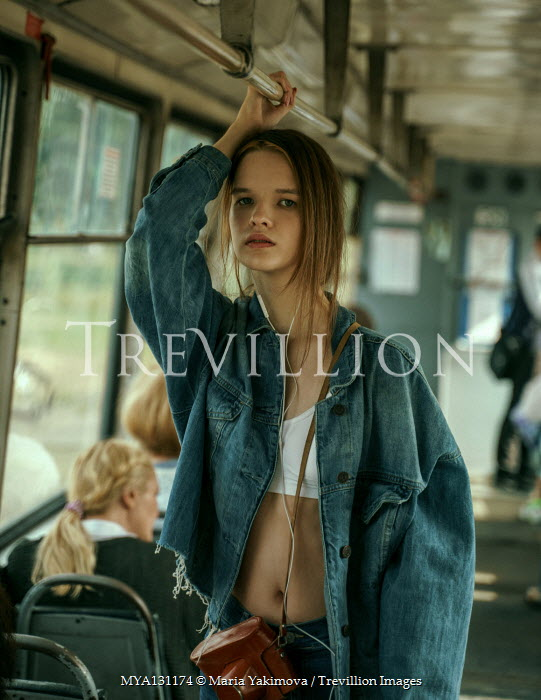 Maria Yakimova Young woman in denim jacket on bus