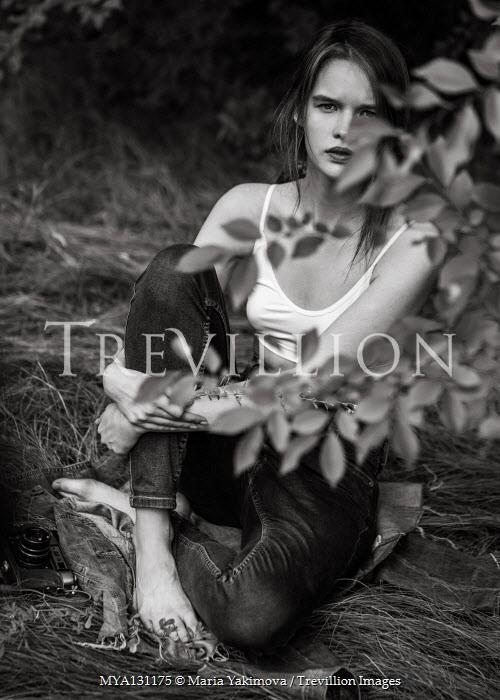 Maria Yakimova Young woman sitting in grass