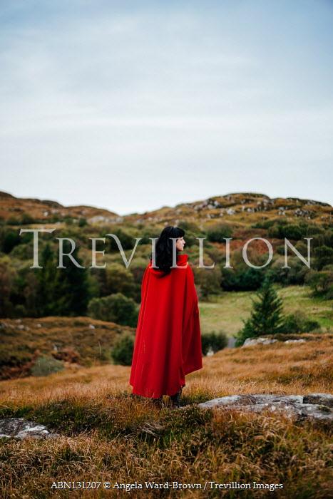 Angela Ward-Brown Woman in red cloak standing in field