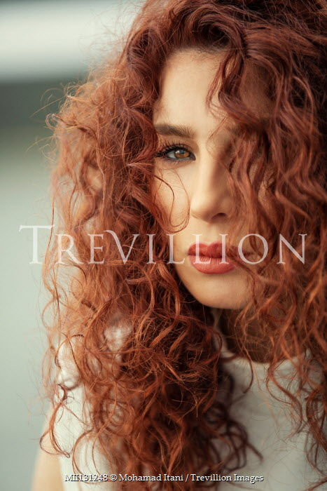 Mohamad Itani Portrait of young woman with curly red hair