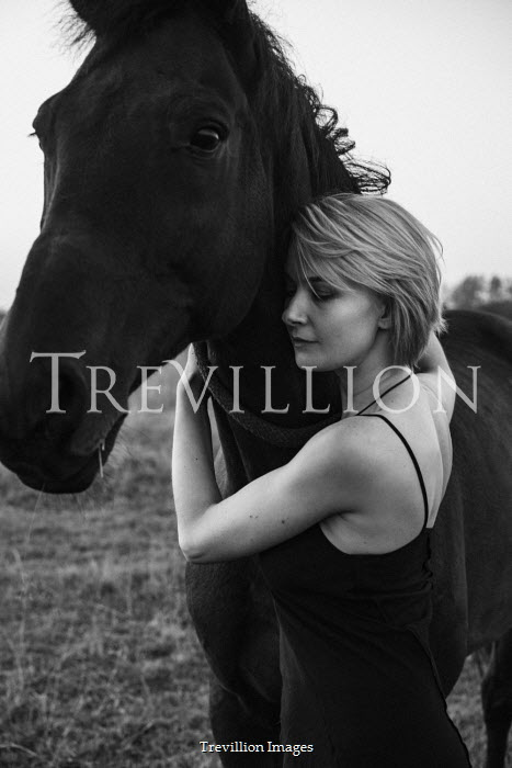 Maria Yakimova Young woman hugging horse