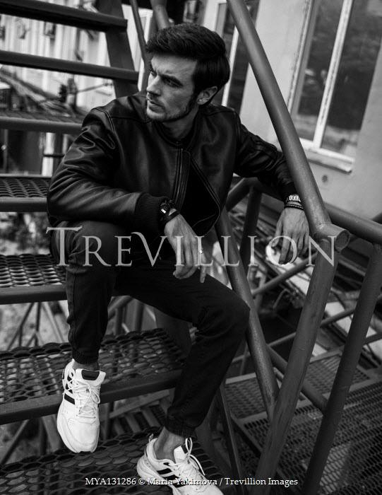 Maria Yakimova Young man sitting on steps